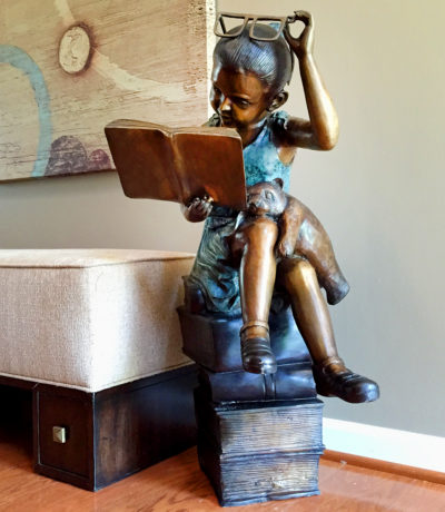 SRB097131 Bronze Girl reading on Books Sculpture Metropolitan Galleries Inc.