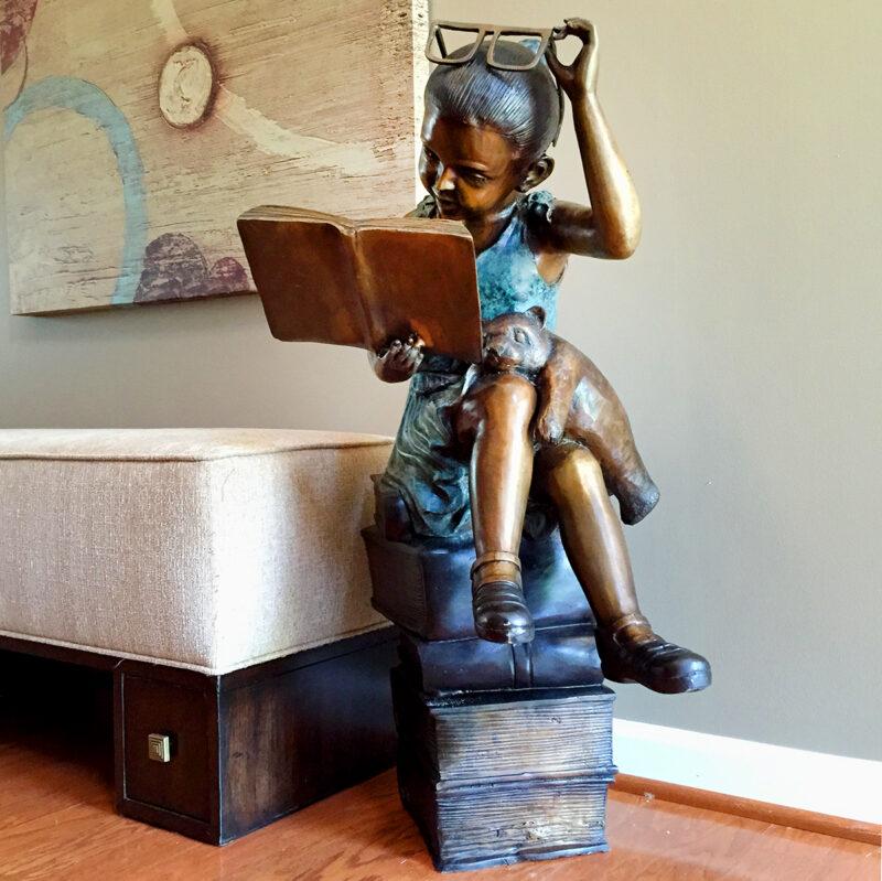 SRB097131 Bronze Girl reading on Books Sculpture Metropolitan Galleries Inc.