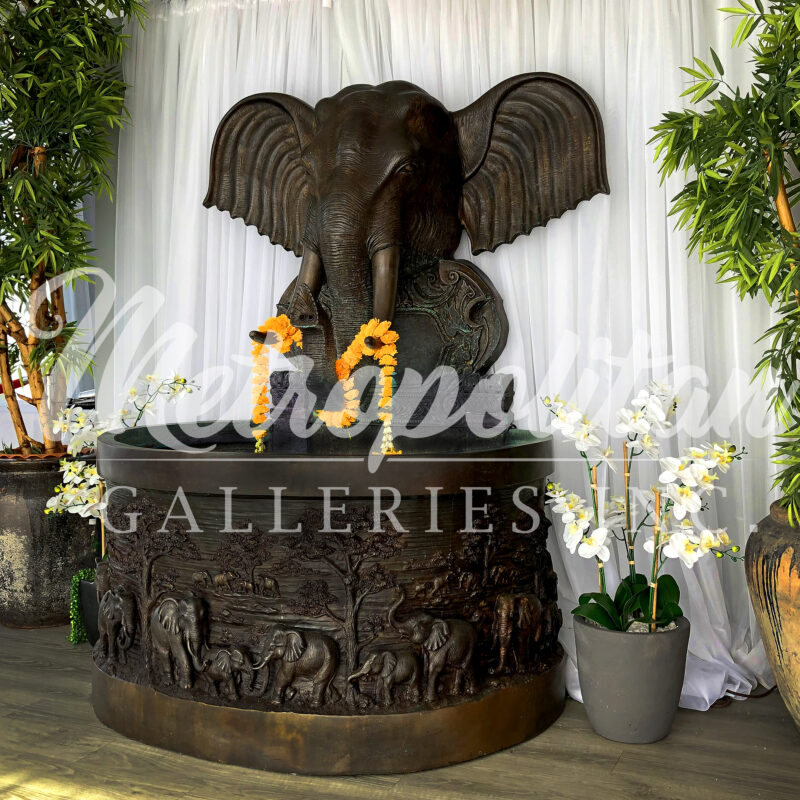 SRB25116 Bronze Elephant Wall Fountain Sculpture by Metropolitan Galleries shown at 98 Asian Bistro in High Point North Carolina USA