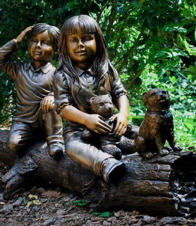 Cast Bronze Sculpture Children and Dog sitting on Log Sculpture Metropolitan Galleries Inc Bronze Sculpture and Fountains
