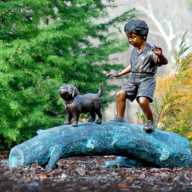 SRB45566 Bronze Boy & Dog Walking on Log Sculpture by Metropolitan Galleries Inc