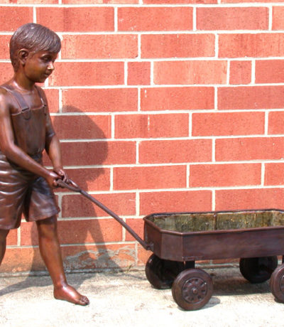 SRB46918 Bronze Boy pulling Wagon Sculpture Metropolitan Galleries Inc.
