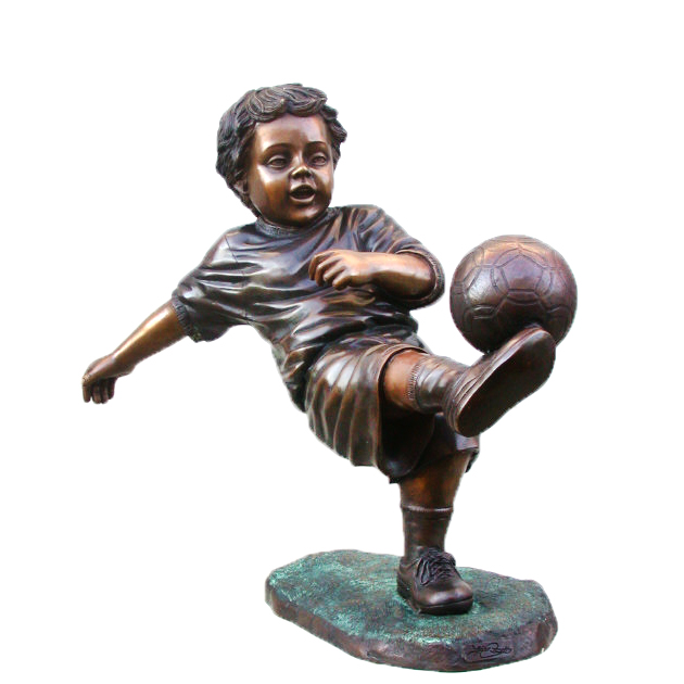 Cast Bronze Boy playing Soccer Sculpture