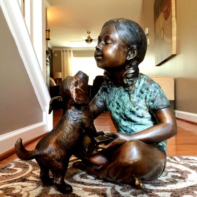 SRB706753 Bronze Sitting Girl with Dog Sculpture by Metropolitan Galleries Inc
