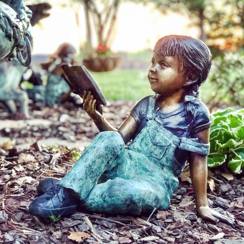 SRB706763 Bronze Girl Reading Book Sculpture in Garden Metropolitan Galleries Inc.