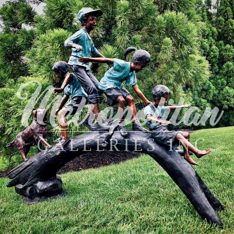 SRB052090 Bronze Four Children & Dog crossing Arched Log Sculpture by Metropolitan Galleries Inc Vignette