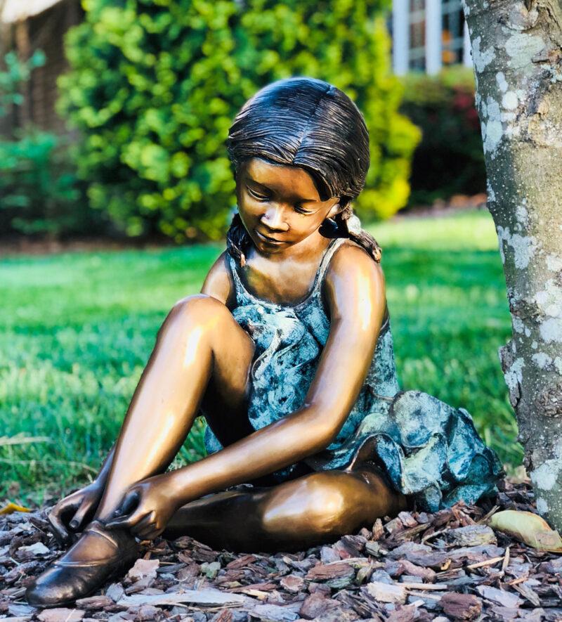 SRB706042 Bronze Ballerina fixing Shoe Sculpture in Garden Metropolitan Galleries Inc.