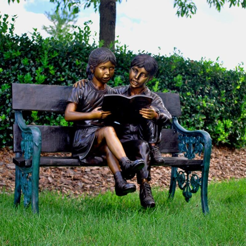 SRB47492 Boy & Girl Reading Book on Bench Bronze Sculpture by Metropolitan Galleries Inc