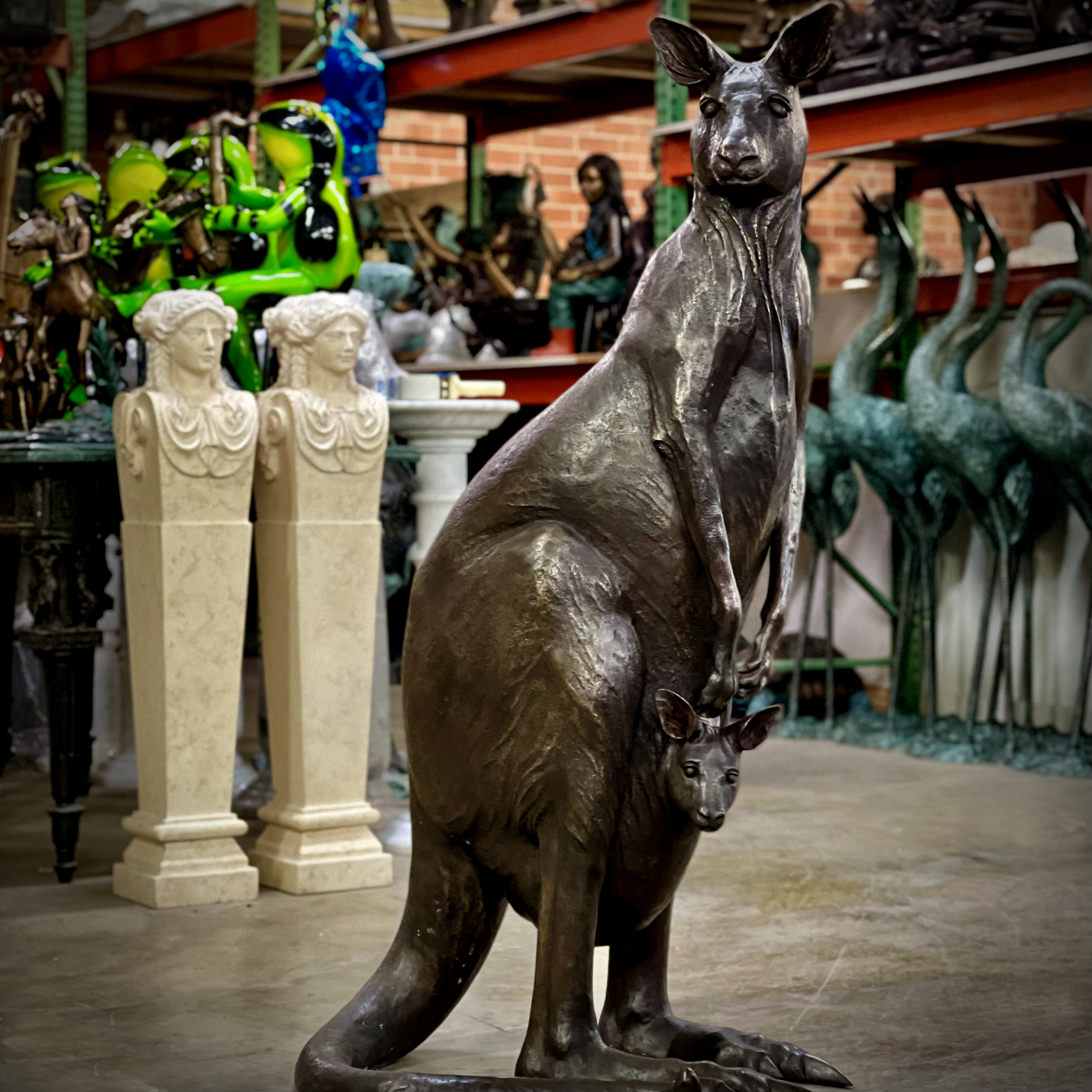 SRB10122 Bronze Mother Kangaroo with Little Joey Sculpture exclusively designed and produced by Metropolitan Galleries Inc warehouse photo